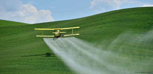 plane spraying herbicide