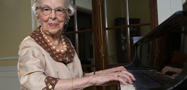 old woman playing piano