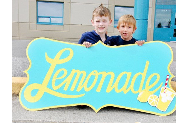 boy sets up lemonade stand to raise money for surgery