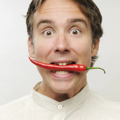 men eat spicy chili pepper