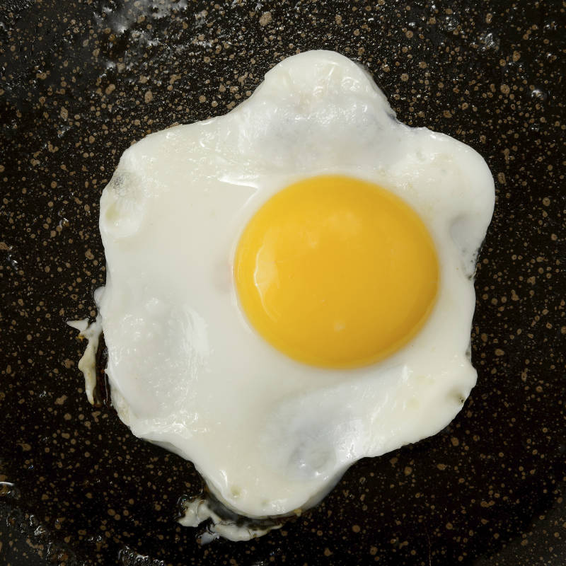 cooking egg on parchment paper